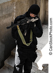 Terrorist with automatic rifle - Armed criminal in black...
