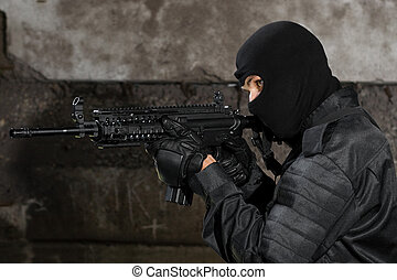 Armed man with automatic rifle