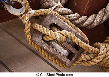 Hessian rope and wooden pulley - Rope and pulley on an old...