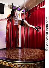 Stripper dancing on pole - Strip tease dancer hanging on the...