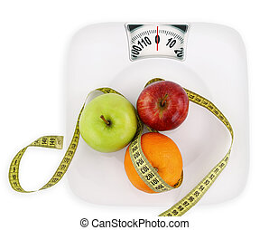 Diet concept. Fruits with measuring tape on a plate like...