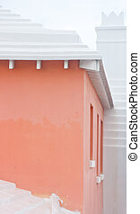Pink Stucco House with White Cement Roof
