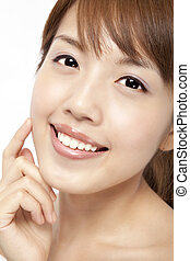 Happy beautiful asian womans face with fresh clean skin