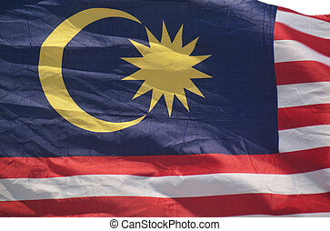Malaysian flag waving with a strong wind