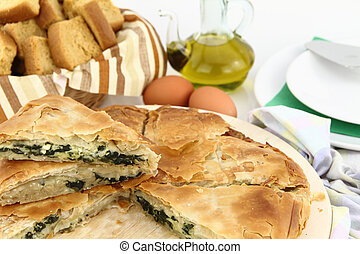 Homemade puff spinach pie with filo pastry