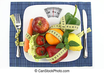 Diet concept - Fruits and vegetables with measuring tape on...