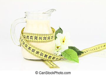 Diet milk in a jug with measuring tape