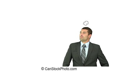 Businessman thinking about a baby against a white background