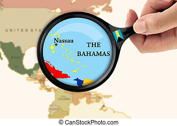Magnifying glass over a map of the Bahamas