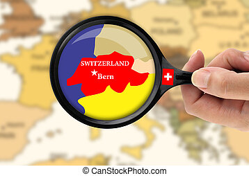 Magnifying glass over a map of Switzerland