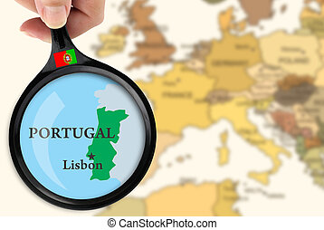 Magnifying glass over a map of Portugal