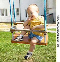 Cute little boy on swing