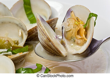 Close up of Spicy Clam Soup - Close up of a spoonful of...