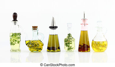 Various bottles of olive oil with herbs inside