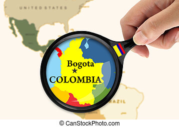 Focus in Colombia - Magnifying glass over a map of Colombia