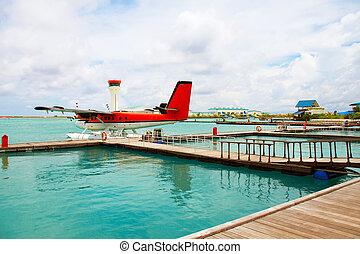 Maldives. A seaplane at a mooring at ocean