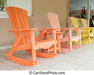 Rocking chairs - colorful wooden rocking chairs on a porch...