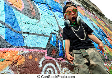 guy - Portrait of a trendy little boy with headphones...