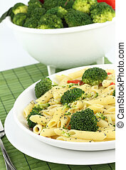 Penne pasta with broccoli on a plate