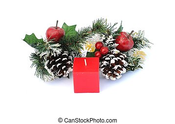 red cubic candle with pine cone and holly