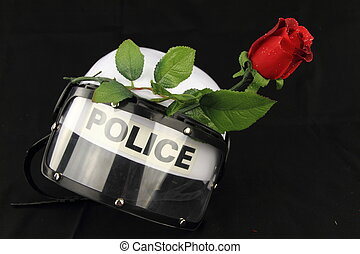 Police helmet and rose A concept against violence