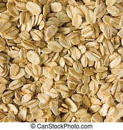 Oatmeal background, rolled raw oats macro closeup - Oatmeal...