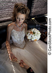 The bride with a crystal shoe. The bride in a wedding dress...
