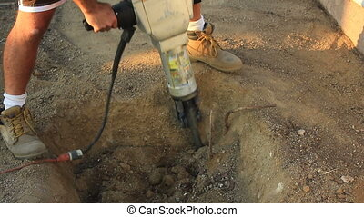 jackhammer hole close - close up of a jackhammer digging a...