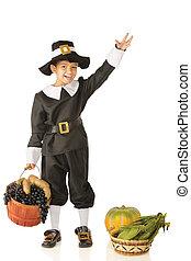 Waving Young Pilgrim - An adorable preschooler in a Pilgrim...