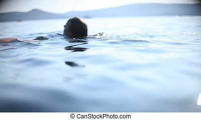 Active swimmer - Young beautiful woman swimming and diving