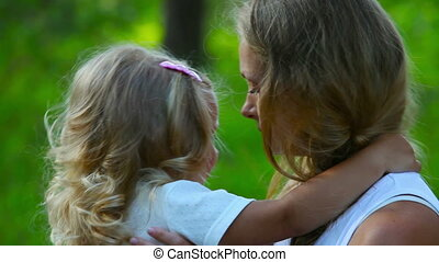 Comforting - Young mother hugging her crying daughter