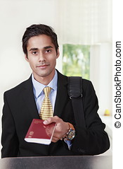 Traveler showing passport - Young male traveler in business...