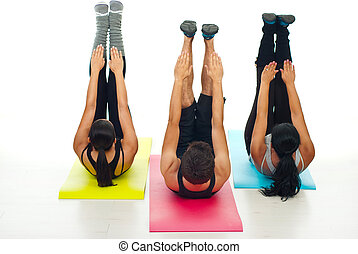Active people workout - Active three people sitting on...
