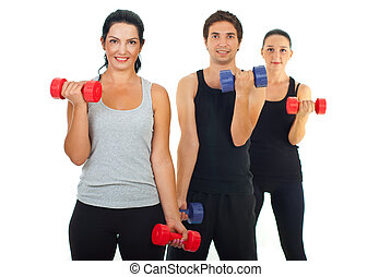 Active people working with barbell