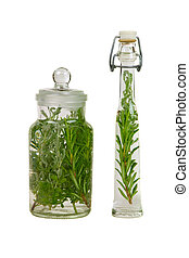Bottle with fresh herbs for medicine or cooking