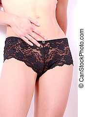 Erotic Moments - Detail of a woman in a black lace top