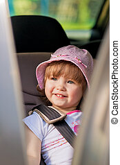 baby girl in car safety seat - young little girl i car...