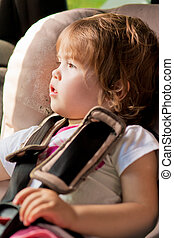 little cute kid in car safety seat - portrait of little kid...