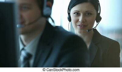 Call canter - Young smiling customer support worker on the...