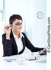 Woman at work - Photo of pretty businesswoman looking at...