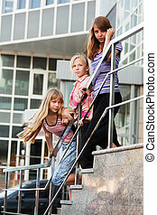 Group of teenage girls on a shop steps