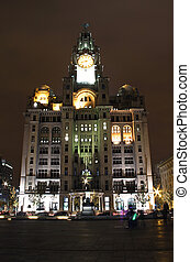 liver building lit up - a full front shot of the iconic...