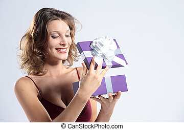 Surprised attractive woman open gift box
