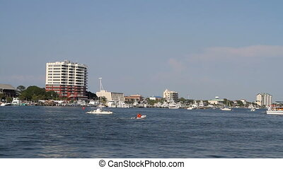 Destin Harbor Boating - Pleasure boats motor around in...