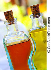 Olive Oil and Vinegar - Glass cruets with olive oil and...