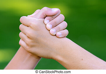 Cool Handshake - Cool handshake between two friends against...