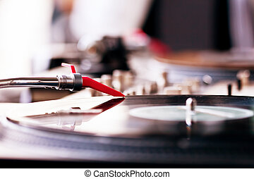 Playing vinyl - Vinyl record spinning on DJ player
