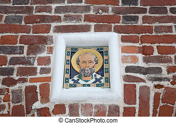 Icon on a brick wall of the Solovetsky monastery.