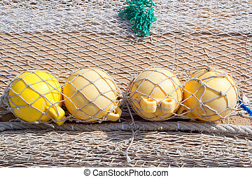 fishing tackle net detail with yellow buoy