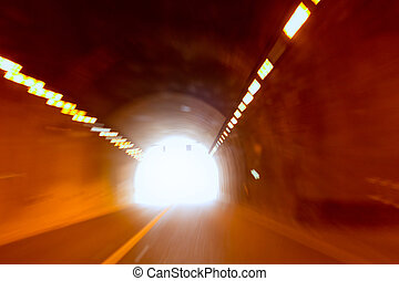 blurred motion tunnel like driving drunk metaphor with light...
